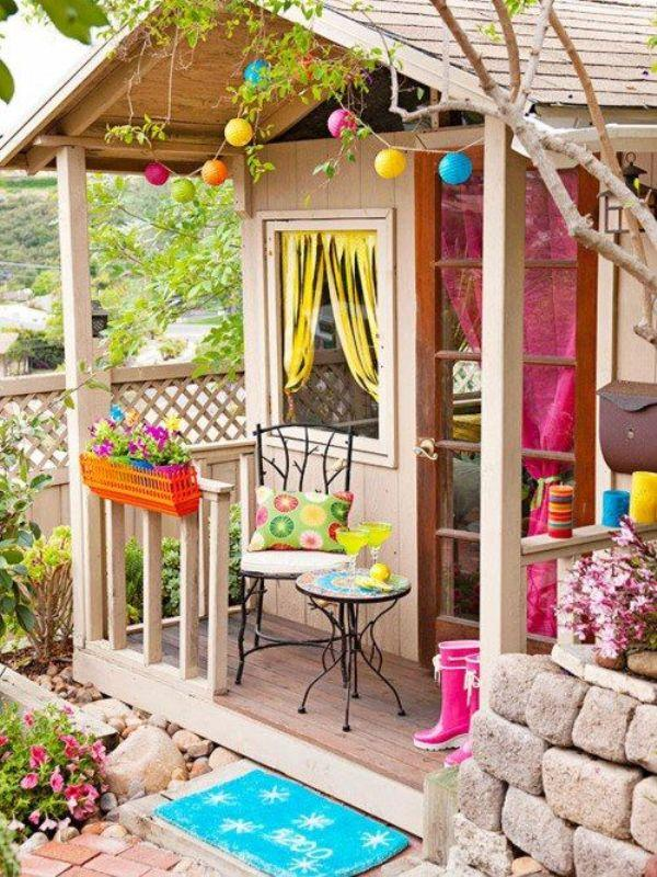15 super awesome kids outdoor playhouses kidsomania for Colorful backyard decorating ideas
