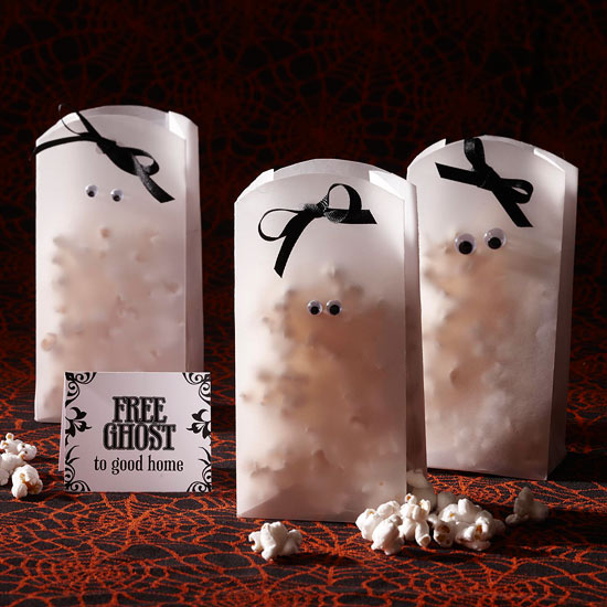 Halloween Crafts - Easy Halloween Craft Ideas for Kids DIY Halloween Treat Bags and a Halloween Candy Cookie Bars Recipe: aboutamom Trick-or-treaters and Halloween party guests will be in for a sweet surprise when candy is presented in these spooky Halloween treat bags.