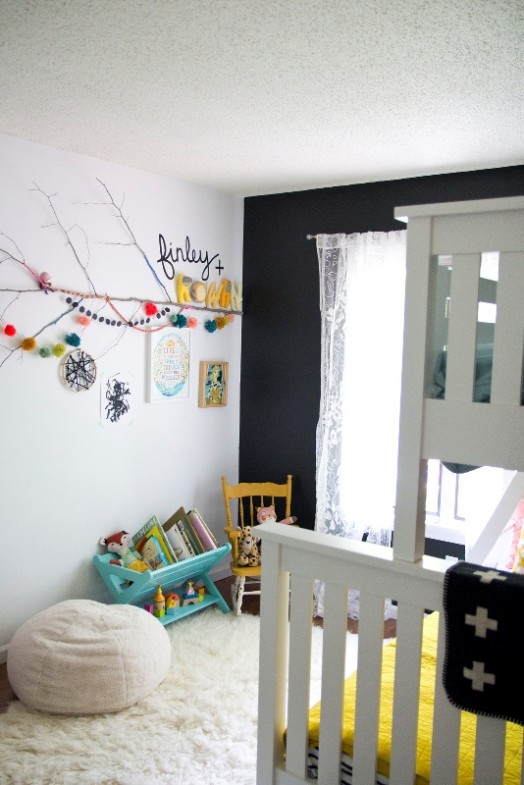 neutral shared girls bedroom design with bright pops of color
