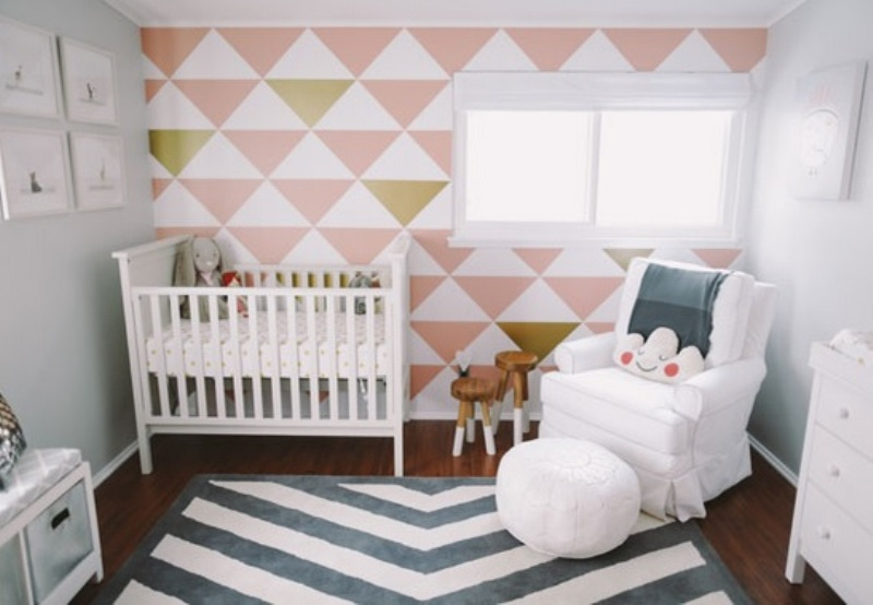 Soft Pink And Gold Baby Nursery Design With An Accent Wall